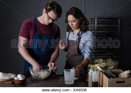 Bakers discussing ingredients - Stock Photo