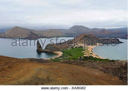 Sullivan Bay and Pinnacle Rock on Bartolomé Island, Galapagos Islands, Ecuador, South America - Stock Photo