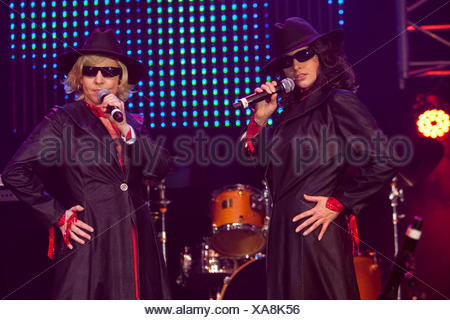 German schlager duo Geschwister Hofmann performing live at the 10th Schlager-Night in the new Allmend Festival Hall, Lucerne - Stock Photo