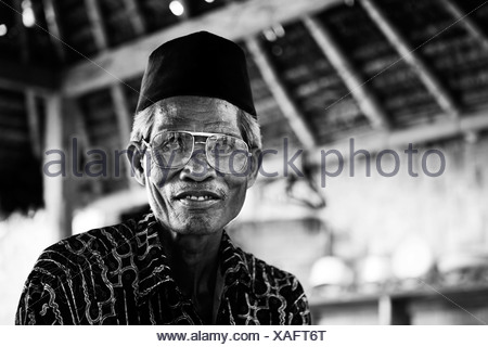 Elderly Indonesian man, portrait, Terara, Lombok island, Nusa Tenggara Barat Province, Indonesia - Stock Photo