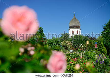Abbey garden and Frauenwoerth church, Frauenchiemsee island, lake Chiemsee, Chiemgau, Upper Bavaria, Bavaria, Germany - Stock Photo