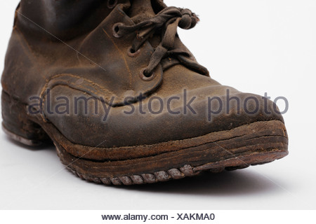 Old mountain boots with nailed soles and iron heels - Stock Photo