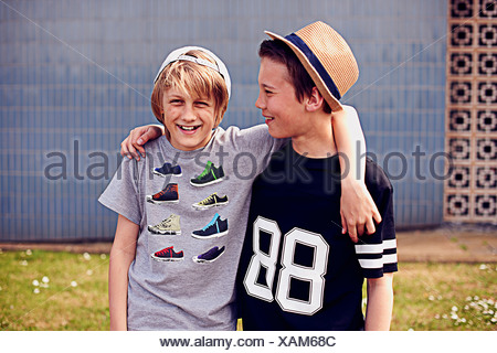 Two boys with arms around each other, portrait - Stock Photo