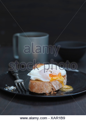 Close up of poached egg on toast - Stock Photo
