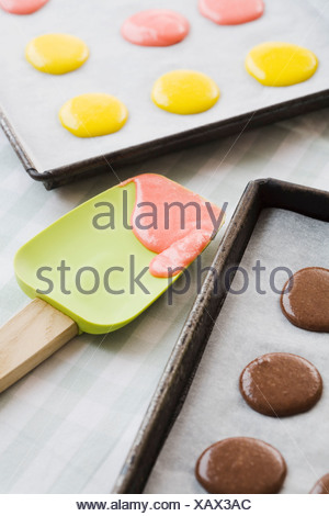 Batter on cookie sheets and spatula - Stock Photo