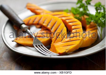 grilled slices of hokkaido pumpkin - Stock Photo