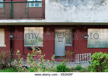 Boarded up flat on a housing estate in the Hackney Borough of London, UK. - Stock Photo