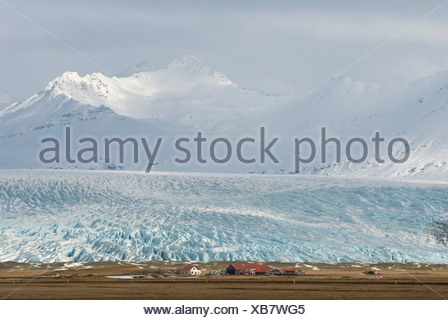Farm by the Flaajoekull Glacier, on the end of the glacier tongue, South Iceland, Europe - Stock Photo