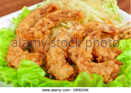 food aliment closeup green hot freshness shrimp angle fish golden kitchen cuisine plate sauce gourmet deep dish meal shellfish - Stock Photo
