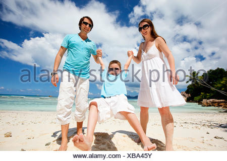 happy young family on tropical beach - Stock Photo