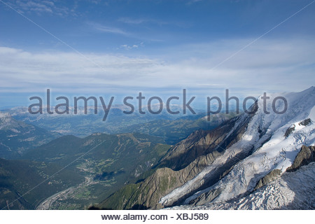 Italy - France Mont Blanc view of Glacier des Bossons and Chamonix in the valley below from Aravis Terrace on Aiguille du Midi - Stock Photo