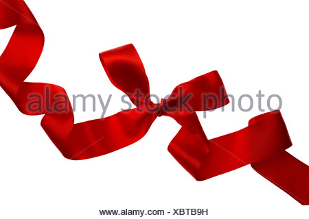 Close-up of a red silk ribbon with a bow against white background - Stock Photo