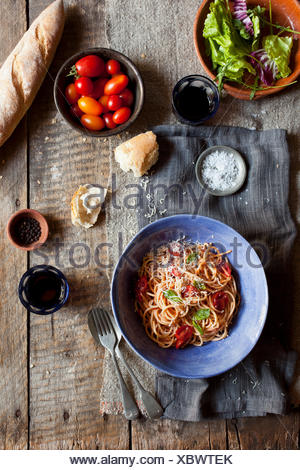 Spaghetti and salad with bread - Stock Photo