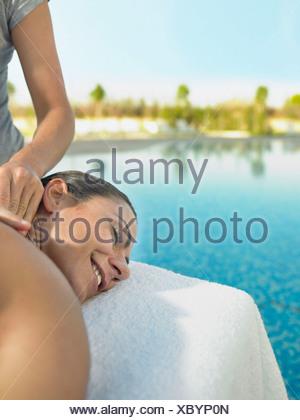 Woman receiving a luxury massage - Stock Photo