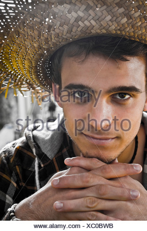 Young man Portrait under heavy sun - Stock Photo