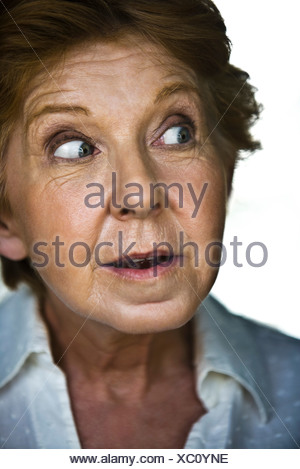 Senior woman displaying look of surprise - Stock Photo