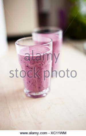 Blueberry smoothie in glasses - Stock Photo