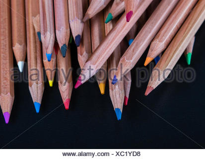 color pencils on black table - Stock Photo