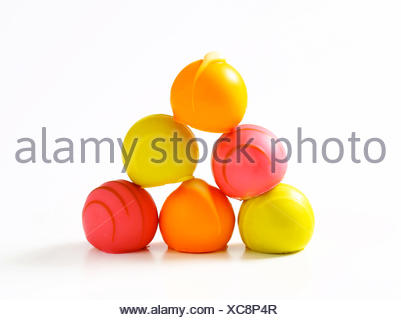 White chocolate bonbons with fruit ganache filling - Stock Photo