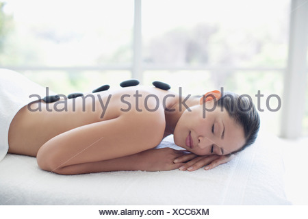 Woman enjoying lastone therapy - Stock Photo