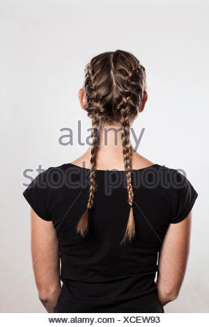Instruction: braided plaits, two 'Gretchen' braids, Step 3 from 3 - Stock Photo