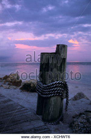 Dock posts and pier at twilight South Seas Resort Captiva Is Florida - Stock Photo