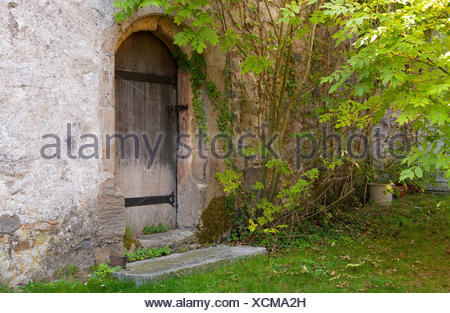 tower door circular arc metal fittings tower stone green door switzerland wall - Stock Photo