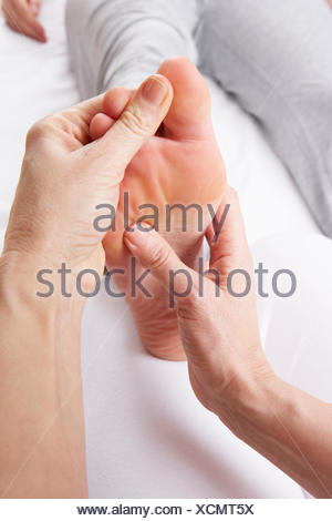 foot,physiotherapist,physical therapy,reflexology,acupressure - Stock Photo