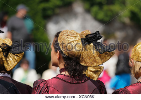 Women in traditional dress with golden headdress, Corpus Christi procession, Traunkirchen, Salzkammergut region, Upper Austria - Stock Photo