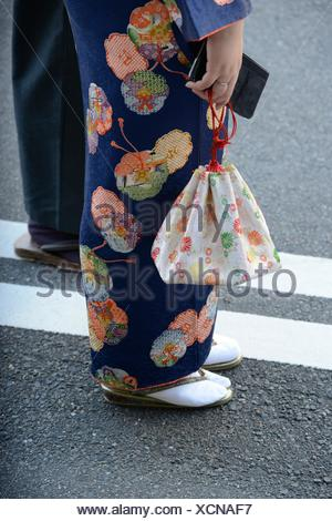 Detail of a woman wearing a traditional japanese kimono, Japan. - Stock Photo