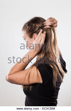 Instruction:  braided plaits, two 'Gretchen' braids, Step 1 from 3 - Stock Photo