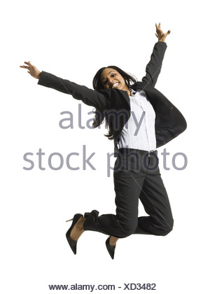 Woman smiling and dancing - Stock Photo