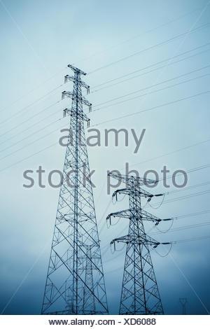 high voltage transmission pylon closeup - Stock Photo