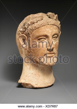 Terracotta head of a man wearing a wreath. Period: Cypro-Classical II; Date: ca. 400-310 B.C; Culture: Cypriot; Medium: Terracotta; mold-made; - Stock Photo