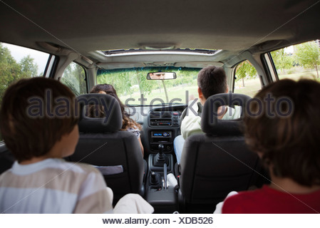 Family riding together in car - Stock Photo