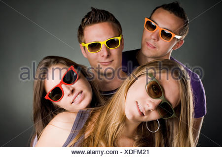 four people with colorful eyeglasses - Stock Photo