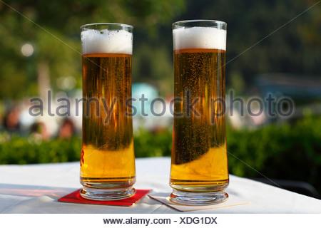 Beer glasses, Strobl, Salzkammergut region, Upper Austria, Austria, Europe - Stock Photo