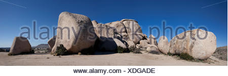 A cluster of granite boulders and formations along the Black Canyon Road in Mojave National Preserve, California. - Stock Photo