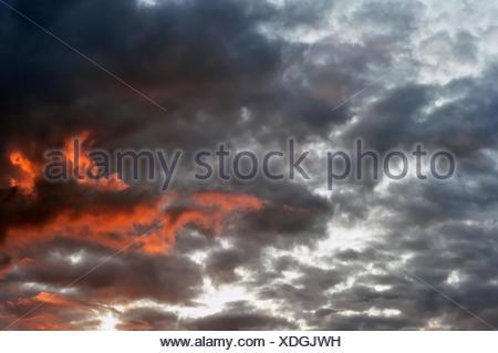 Evening Sky with Dark Fiery Clouds - Stock Photo