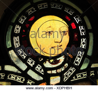 English Medieval stained glass window, Man in Moon, Burnham Deepdale, Norfolk England UK - Stock Photo