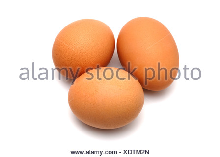 Three chicken eggs on a white background largly - Stock Photo
