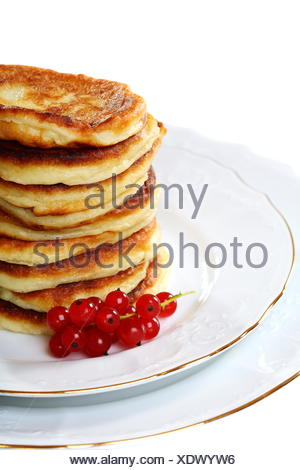 Pancakes with red currants. - Stock Photo