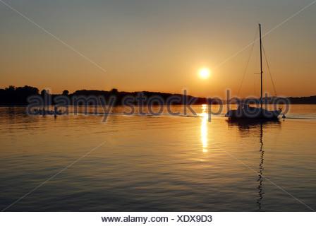 Sunset with sailing boat on lake Chiemsee, Chiemgau, Oberbayern, Bayern, Deutschland - Stock Photo