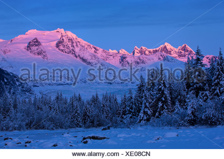 Panoramic view of alpenglow on the Coast Mountains above Mendenhall Glacier, Tongass National Forest, Southeast Alaska, Winter - Stock Photo