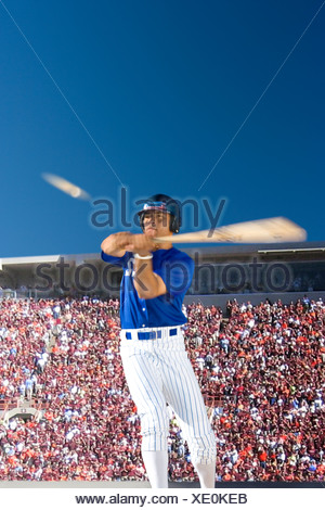 Batter swinging at baseball - Stock Photo