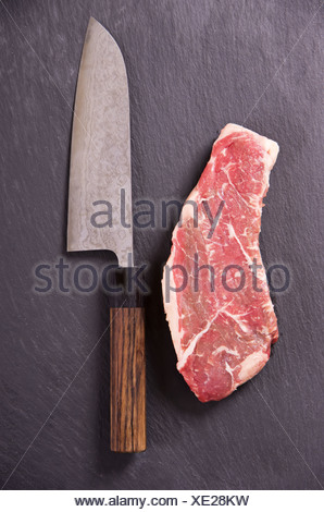 beef steak with japanese santoku knife - Stock Photo