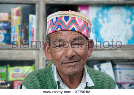 Portrait, Man wearing a typical brightly coloured decorated cap, Manali, Kullu district, the Himalayas, Himachal Pradesh, India - Stock Photo