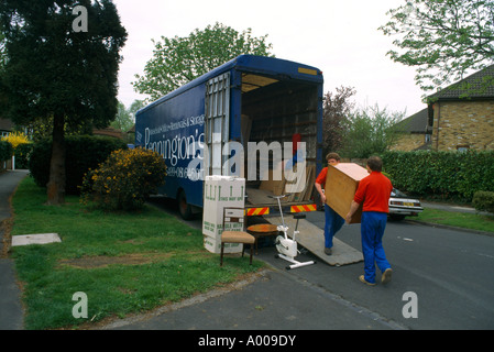 Removal Men Moving Furniture into Lorry - Stock Photo