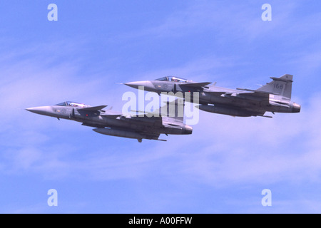 SAAB JAS 39 Gripen jet fighters operated by the Swedish Air Force departing RAF Fairford - Stock Photo