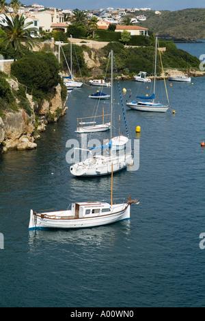 dh Cala Padera ES CASTELL MENORCA Pleasure boats yachts anchored in bay below holiday villas - Stock Photo